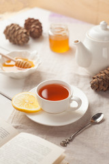 tea and honey on white background, winter or autumn concept, vertical