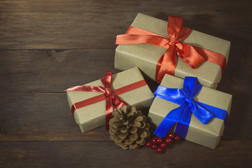 Packaged gifts tied with red and blue ribbons, lump and viburnum