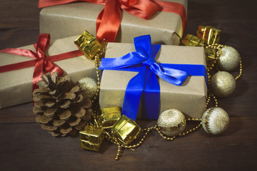 Packed gifts tied with ribbons, decorative toys, a lump