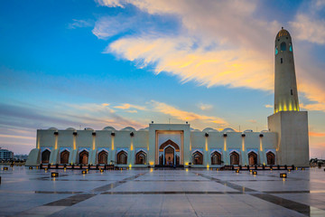 Qatar State Mosque  (Imam Muhammad ibn Abd al-Wahhab Mosque) exterior view at sunset with clouds in the sky