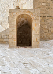 Ancient crypt entrance, bricks stone wall and tiled stone floor beside Kayet bay castle, Alexandria, Egypt