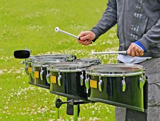 Drum set and drummer's hands.