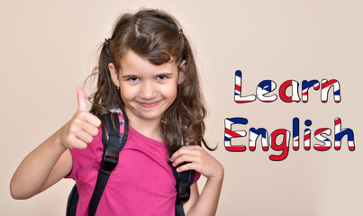 Smiling cute young girl showing thumb up with text Learn English