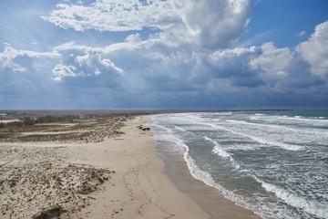 Sun rays on the sandy sea coast