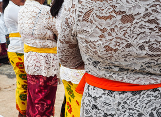 Group of women dressed in traditional clothing waiting in line for the Balinese New year procession, Nusa Lembongan,Indonesia