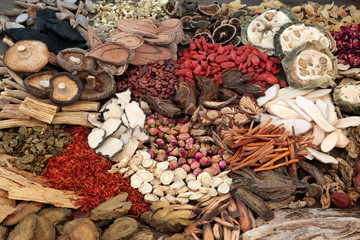 Traditional chinese herbs used in herbal medicine forming a background.
