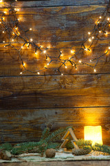christmas decorations and lights on wooden background