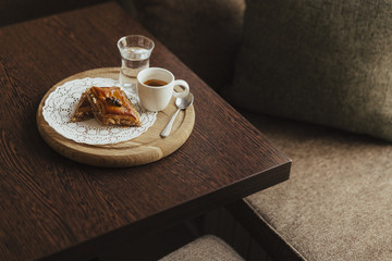 Espresso and dessert on cutting board