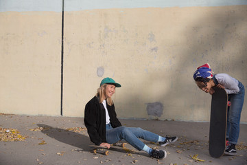 Two young women with skateboards