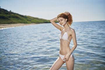 Caucasian woman standing in ocean