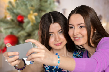 Two young girls using smart phone.