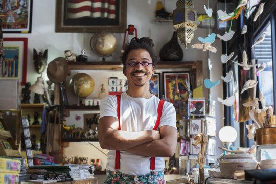 Man in suspenders standing in a shop