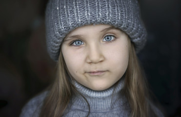 Close up of girl wearing knit hat