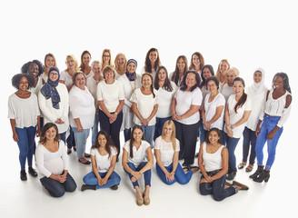 Portrait of crowd of diverse smiling women