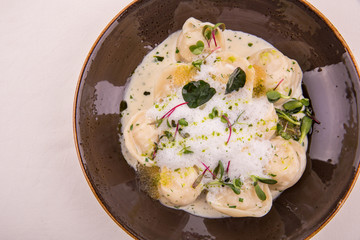 Pike Dumplings with creamy sauce from a pike, is served with champagne sauce and pike caviar