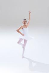 Female teenager in dancing pose