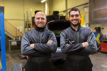 auto mechanics or tire changers at car shop