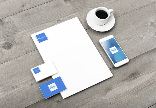Stationery and Smartphone Mockup with Espresso on Wooden Table