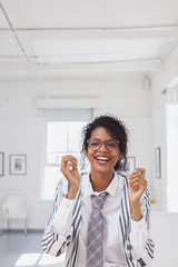 Mixed Race businesswoman laughing