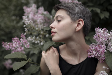 Profile of Caucasian woman standing in flowers