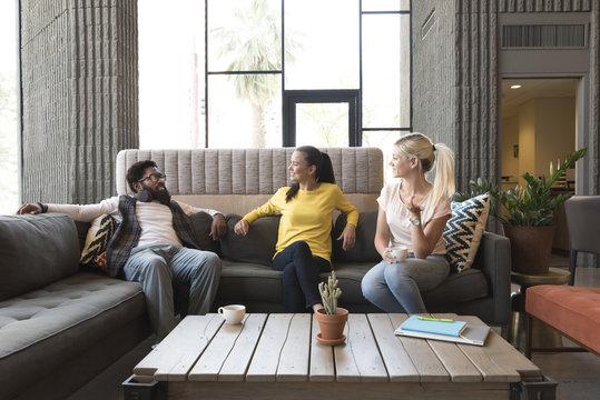 Friends talking in lounge