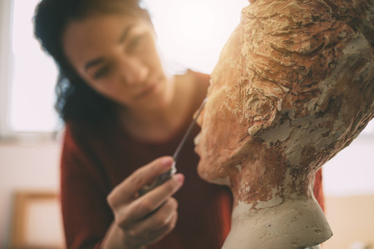Artist is working in an atelier. Art and Sculpture.