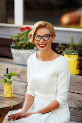 Sexy blonde girl with glasses in retro look