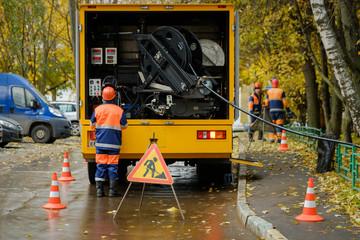 Workers conduct water pipe repair work in the street