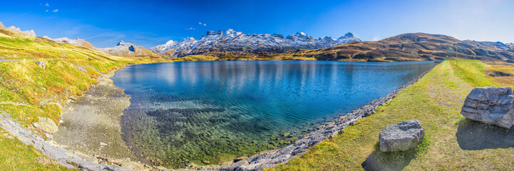 In de dag Lavendel Crystal clear Melchsee and Swiss Alps panorama from Melchsee Frutt, Obwalden, Switzerland, Europe