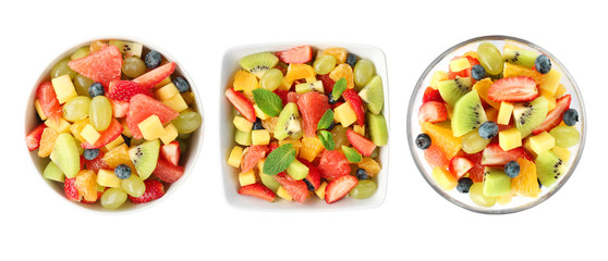 Bowls with fruit salads on white background