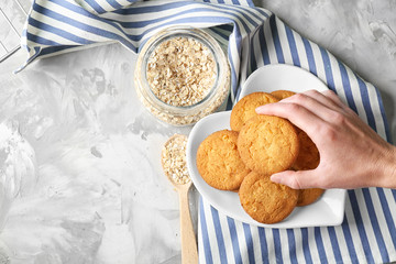 Printed roller blinds Cookies Woman taking oatmeal cookie from plate