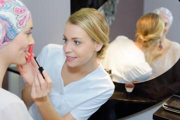 putting makeup on a star