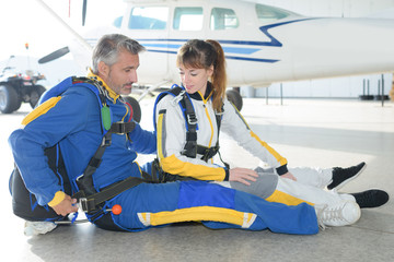 People practicing for tandem parachute jump