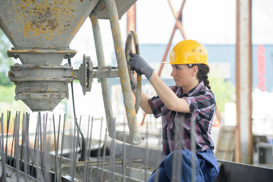 female woman mason working with cement outdoors