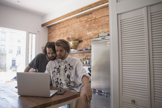 Gay couple using a laptop together