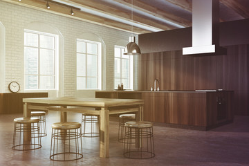 Concrete and dark wooden dining room, side toned