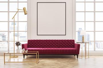 White living room, red sofa, poster
