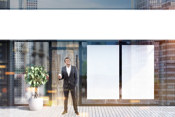 Cafe exterior, two posters, businessman