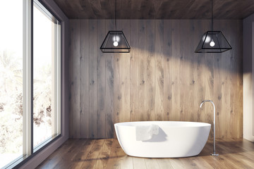 Wooden bathroom with a white tub