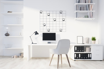 White home office interior, computer front