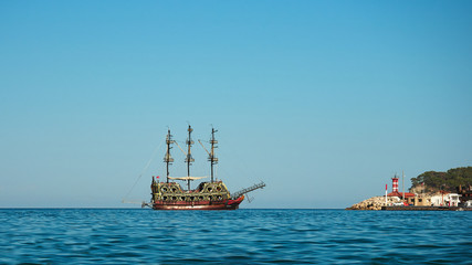 Beautiful retro sailing ship on the high seas. View from coastline