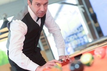 portrait of a young professional playing snooker
