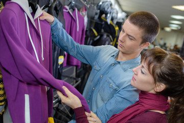 Young couple looking at casual tops