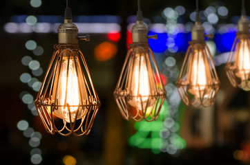 Row of vintage light bulb decor with bokeh background