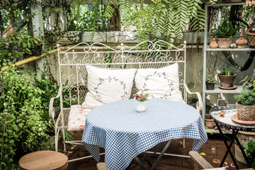empty outdoor patio table and chair decoration in garden