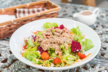 tuna with vegetables salad, sesame and spicy sauce
