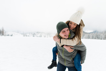 Romantic teen couple having fun in snow
