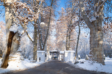 Advent market with closed foodstallt and sunny weather and blue sky with snow in Zrinjevac Park in Zagreb in winter, Croatia, Europe