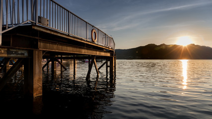 Dock at Lake and Mountain at Sunset or Sunrise