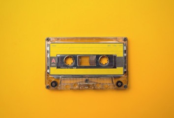 audio cassete on yellow background